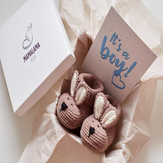 Baby boy reveal gift for shower party. Organic newborn crib funny animal bunny booties present basket. Pregnancy expecting baby boy congrats